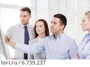Купить «business team discussing something in office», фото № 6739237, снято 5 апреля 2014 г. (c) Syda Productions / Фотобанк Лори