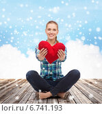 Купить «young woman with red heart pillow sitting on floor», фото № 6741193, снято 12 февраля 2014 г. (c) Syda Productions / Фотобанк Лори