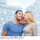 Купить «smiling girlfriend telling boyfriend secret», фото № 6741217, снято 9 февраля 2014 г. (c) Syda Productions / Фотобанк Лори