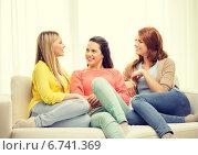 Купить «three girlfriends having a talk at home», фото № 6741369, снято 12 апреля 2014 г. (c) Syda Productions / Фотобанк Лори