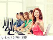 Купить «female student with classmates in computer class», фото № 6764989, снято 4 мая 2014 г. (c) Syda Productions / Фотобанк Лори