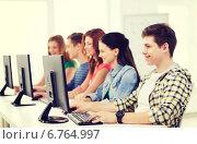 Купить «male student with classmates in computer class», фото № 6764997, снято 4 мая 2014 г. (c) Syda Productions / Фотобанк Лори