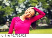 Купить «smiling black woman stretching leg outdoors», фото № 6765029, снято 19 июня 2014 г. (c) Syda Productions / Фотобанк Лори