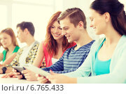 Купить «smiling students with tablet pc at school», фото № 6765433, снято 4 мая 2014 г. (c) Syda Productions / Фотобанк Лори