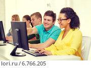 Купить «smiling students in computer class at school», фото № 6766205, снято 29 марта 2014 г. (c) Syda Productions / Фотобанк Лори