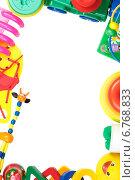Купить «Рамка из детских игрушек. Место для текста», фото № 6768833, снято 16 ноября 2014 г. (c) Йомка / Фотобанк Лори
