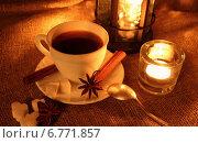 Купить «Чашка кофе и горящие свечи», фото № 6771857, снято 7 декабря 2014 г. (c) Шуба Виктория / Фотобанк Лори