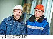 Купить «Construction builder workers», фото № 6775237, снято 27 ноября 2014 г. (c) Дмитрий Калиновский / Фотобанк Лори