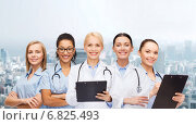 Купить «smiling female doctors and nurses with stethoscope», фото № 6825493, снято 1 декабря 2013 г. (c) Syda Productions / Фотобанк Лори