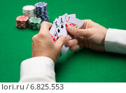 Купить «poker player with cards and chips at casino», фото № 6825553, снято 16 мая 2014 г. (c) Syda Productions / Фотобанк Лори
