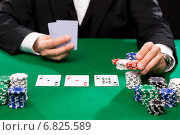 Купить «poker player with cards and chips at casino», фото № 6825589, снято 16 мая 2014 г. (c) Syda Productions / Фотобанк Лори