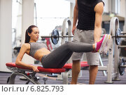 Купить «woman with trainer doing abdominal exercise in gym», фото № 6825793, снято 30 ноября 2014 г. (c) Syda Productions / Фотобанк Лори
