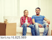 Купить «smiling couple relaxing on sofa in new home», фото № 6825989, снято 26 января 2014 г. (c) Syda Productions / Фотобанк Лори