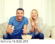 Купить «smiling couple with popcorn cheering sports team», фото № 6826201, снято 9 февраля 2014 г. (c) Syda Productions / Фотобанк Лори