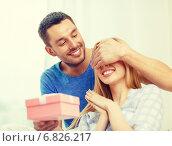 Купить «smiling man surprises his girlfriend with present», фото № 6826217, снято 9 февраля 2014 г. (c) Syda Productions / Фотобанк Лори