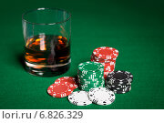 Купить «close up of casino chips and whisky glass on table», фото № 6826329, снято 17 октября 2014 г. (c) Syda Productions / Фотобанк Лори