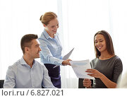 Купить «smiling business people with papers in office», фото № 6827021, снято 25 октября 2014 г. (c) Syda Productions / Фотобанк Лори