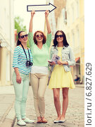 Купить «smiling teenage girls with white arrow outdoors», фото № 6827629, снято 25 мая 2014 г. (c) Syda Productions / Фотобанк Лори