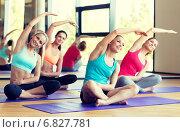 Купить «group of smiling women stretching in gym», фото № 6827781, снято 7 июня 2014 г. (c) Syda Productions / Фотобанк Лори