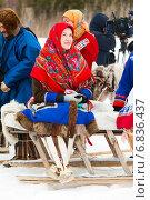 Купить «Женщина-оленевод в национальном костюме ханты на нартах», фото № 6836437, снято 14 марта 2014 г. (c) Владимир Мельников / Фотобанк Лори