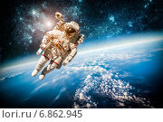 Купить «Astronaut in outer space», фото № 6862945, снято 9 февраля 2013 г. (c) Андрей Армягов / Фотобанк Лори