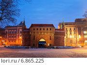 Купить «Оборонительная башня барбакан - ворота в средневековый Краков», фото № 6865225, снято 2 января 2015 г. (c) Наталья Волкова / Фотобанк Лори