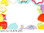 Купить «Рамка из разноцветных детских игрушек», фото № 6874293, снято 16 ноября 2014 г. (c) Йомка / Фотобанк Лори