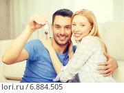 Купить «smiling couple holding keys at home», фото № 6884505, снято 9 февраля 2014 г. (c) Syda Productions / Фотобанк Лори