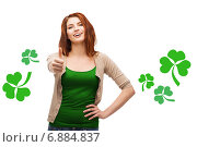 Купить «smiling teen girl with shamrock showing thumbs up», фото № 6884837, снято 27 ноября 2013 г. (c) Syda Productions / Фотобанк Лори