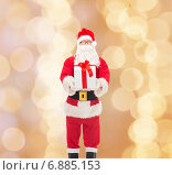 Купить «man in costume of santa claus with gift box», фото № 6885153, снято 10 сентября 2014 г. (c) Syda Productions / Фотобанк Лори