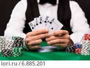 poker player with cards and chips at casino. Стоковое фото, фотограф Syda Productions / Фотобанк Лори