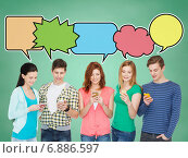 Купить «happy friends showing blank smartphones screens», фото № 6886597, снято 4 мая 2014 г. (c) Syda Productions / Фотобанк Лори