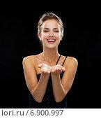 Купить «laughing woman in evening dress holding something», фото № 6900997, снято 1 июня 2014 г. (c) Syda Productions / Фотобанк Лори