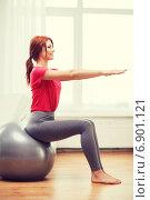 Купить «smiling redhead girl exercising with fitness ball», фото № 6901121, снято 19 марта 2014 г. (c) Syda Productions / Фотобанк Лори