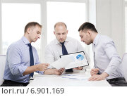 Купить «serious businessmen with papers in office», фото № 6901169, снято 10 мая 2014 г. (c) Syda Productions / Фотобанк Лори