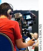 Профессиональный оператор в наушниках. Стоковое фото, фотограф Максим Блинков / Фотобанк Лори