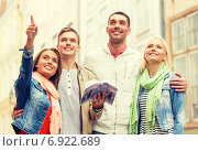 Купить «group of friends with city guide exploring town», фото № 6922689, снято 14 июня 2014 г. (c) Syda Productions / Фотобанк Лори