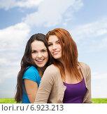 Купить «smiling teenage girls hugging», фото № 6923213, снято 27 ноября 2013 г. (c) Syda Productions / Фотобанк Лори