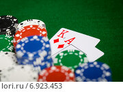 Купить «close up of casino chips and playing cards», фото № 6923453, снято 17 октября 2014 г. (c) Syda Productions / Фотобанк Лори