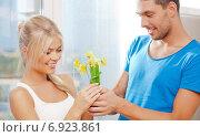 Купить «romantic couple with flowers», фото № 6923861, снято 4 августа 2012 г. (c) Syda Productions / Фотобанк Лори