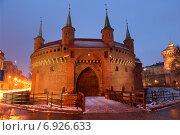 Купить «Оборонительная башня барбакан - ворота в средневековый Краков», фото № 6926633, снято 2 января 2015 г. (c) Наталья Волкова / Фотобанк Лори