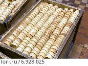 Купить «Ящики с подготовленными вафельными стаканчиками для мороженого», фото № 6928025, снято 25 декабря 2014 г. (c) Евгений Ткачёв / Фотобанк Лори