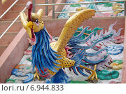Купить «Скульптура в виде птицы - украшение храма Wat Thavorn Wararam в Канчанабури, Таиланд», фото № 6944833, снято 11 января 2015 г. (c) Natalya Sidorova / Фотобанк Лори