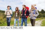 Купить «group of smiling friends with backpacks hiking», фото № 6946389, снято 31 августа 2014 г. (c) Syda Productions / Фотобанк Лори