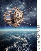 Space satellite over the planet earth. Стоковое фото, фотограф Андрей Армягов / Фотобанк Лори