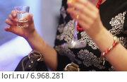 Купить «Женщина со стопкой в руке», видеоролик № 6968281, снято 9 января 2015 г. (c) Потийко Сергей / Фотобанк Лори