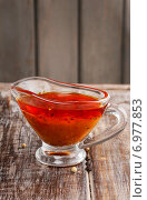 Купить «Honey and pepper red marinade in glass gravy boat on wooden table», фото № 6977853, снято 16 июля 2018 г. (c) BE&W Photo / Фотобанк Лори