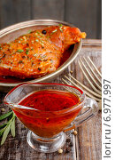 Купить «Honey and pepper red marinade in glass gravy boat on wooden table», фото № 6977997, снято 16 июля 2018 г. (c) BE&W Photo / Фотобанк Лори