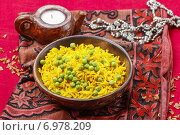 Купить «Indian cuisine: bowl of yellow rice with green peas on red background», фото № 6978209, снято 22 июля 2018 г. (c) BE&W Photo / Фотобанк Лори