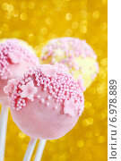 Купить «Pink and yellow cake pops decorated with sprinkles. Gold glittering background», фото № 6978889, снято 23 марта 2019 г. (c) BE&W Photo / Фотобанк Лори